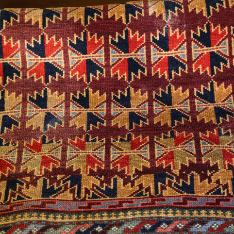 Colourful patterned rug detail