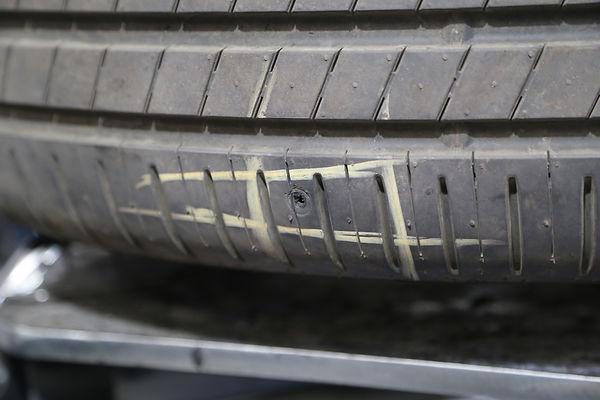 Screw hole in a tyre.JPG