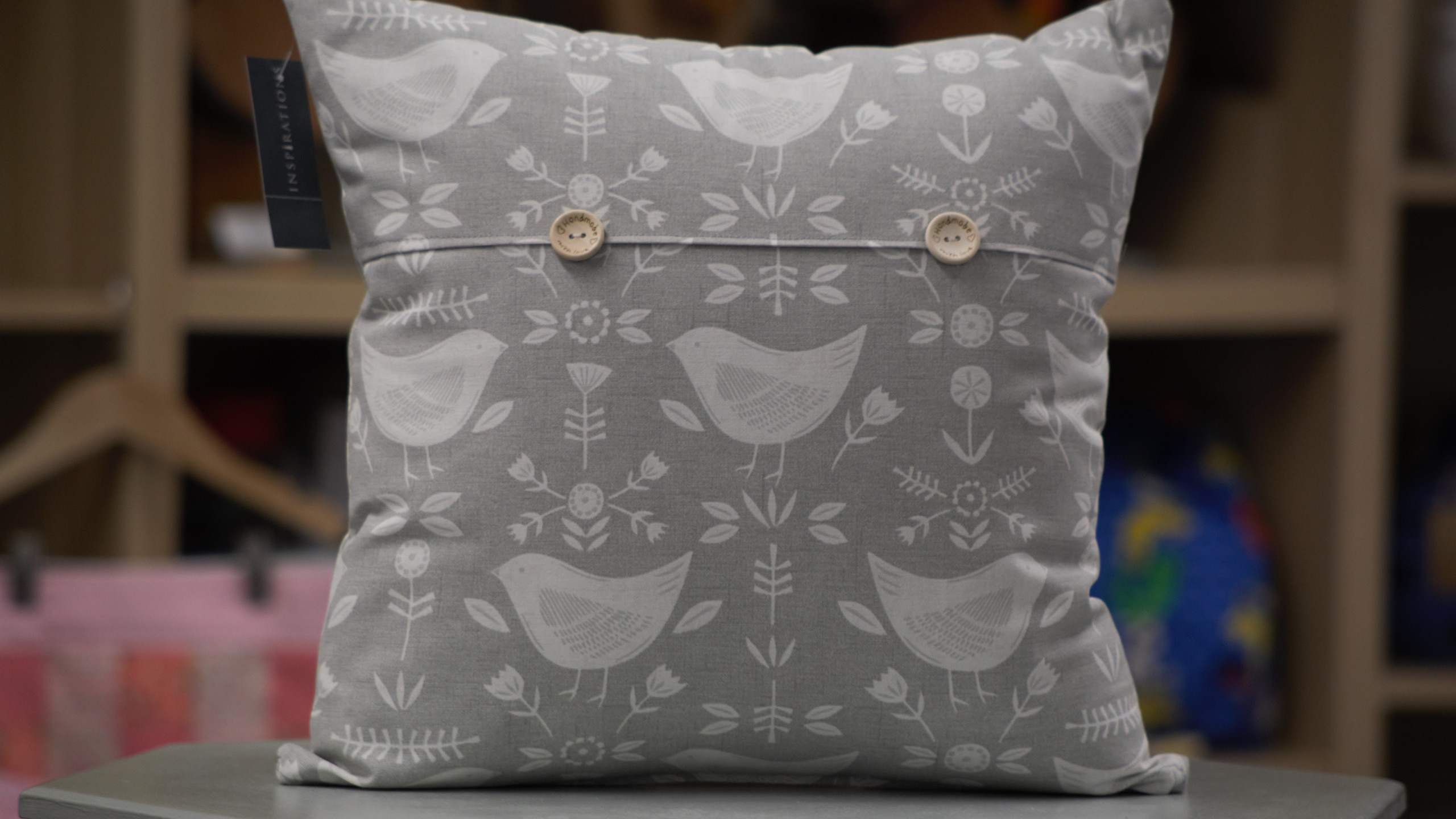 Birds and buttons cushion