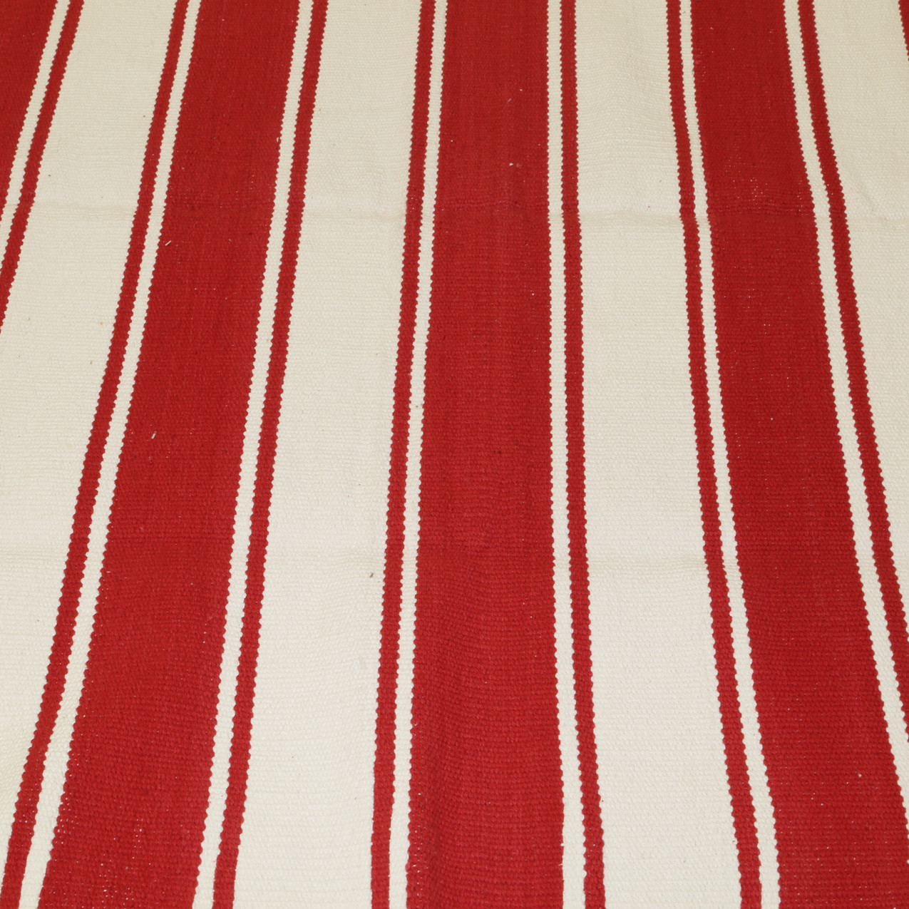 Red and white stripped rug