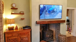 "55"" LED TV on chimney breast"