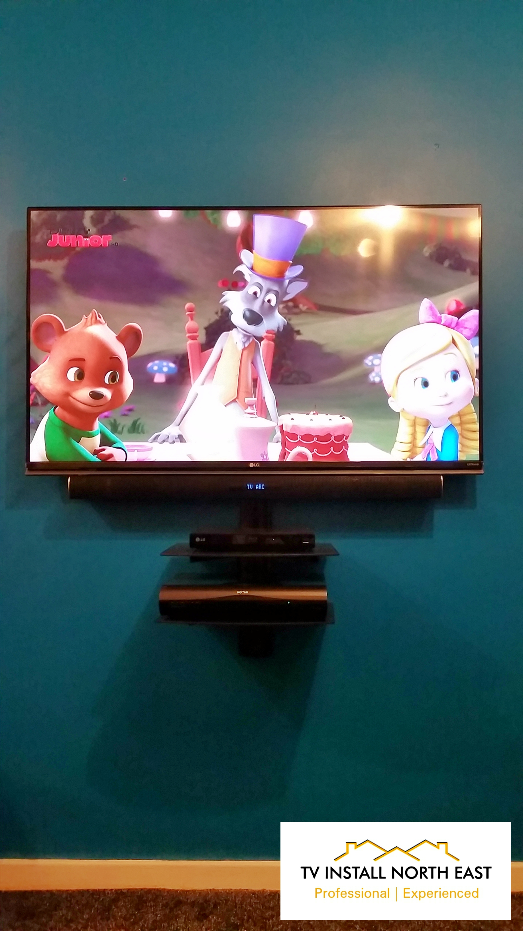 "LG 51"" LED TV with floating shelves"