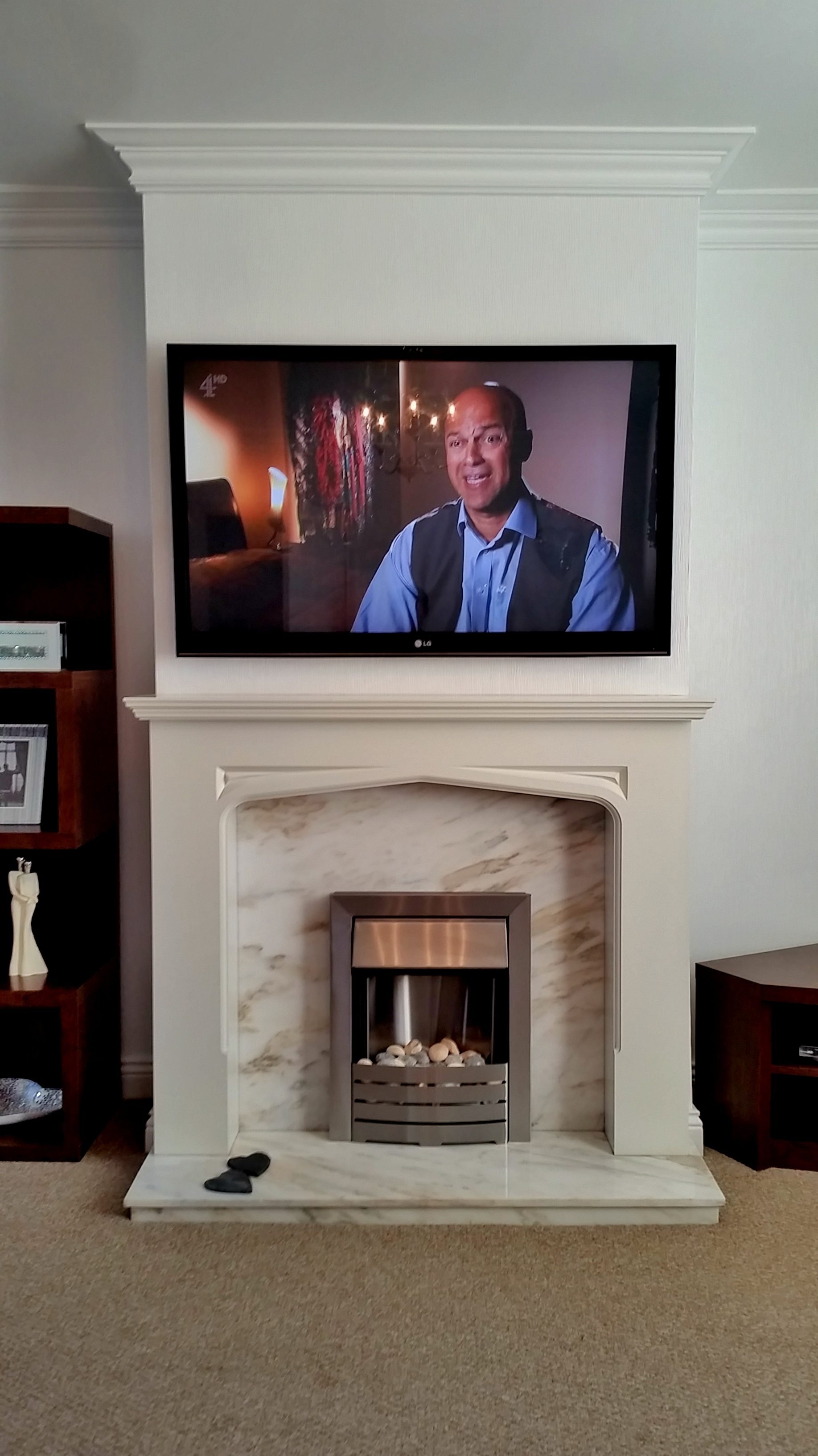 Samsung Plasma TV above Fire