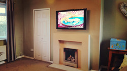 "50"" LCD TV above fire"