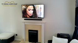 """Sony 49"""" LED TV above electric fire"""