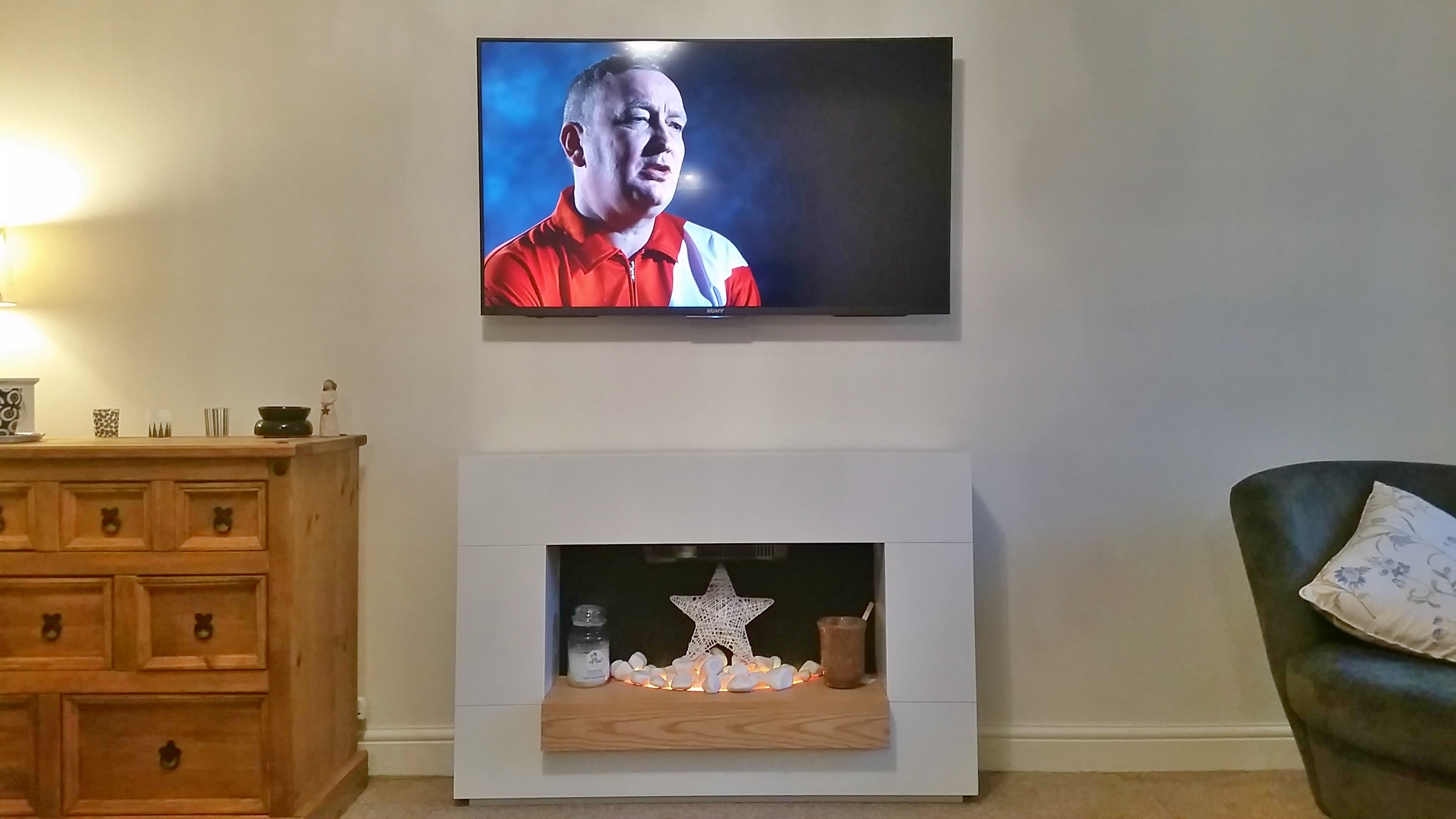 "Sony 49"" LED TV above electric fire"