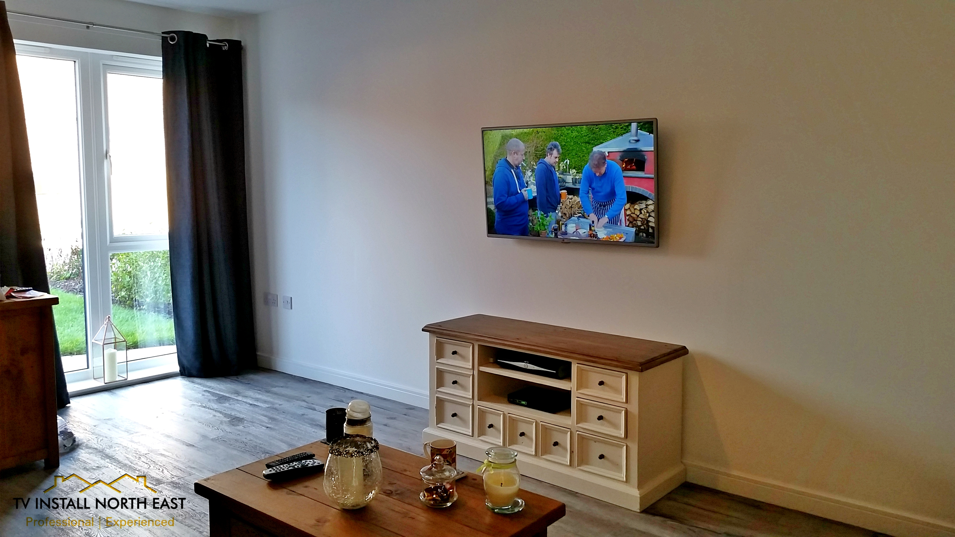 "Panasonic 42"" LED TV above fire"