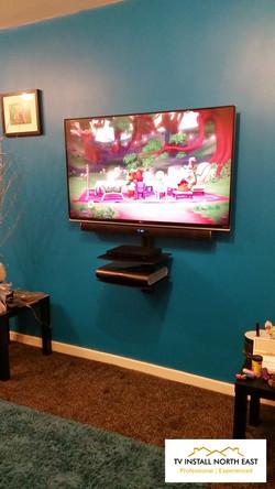 "LG 49"" LED TV with Soundbar"