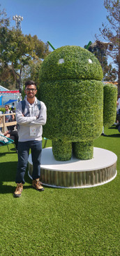 One with the green Android statue at Google I/O 2019.