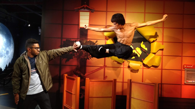 Stopping Bruce Lee's kick in Madame Tussaud's Wax Museum.