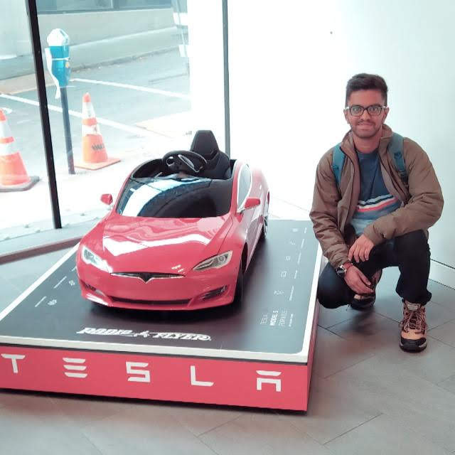 One with a mini Tesla car in San Francisco.