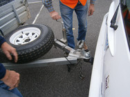 Volunteers leaning how to attach a trailer
