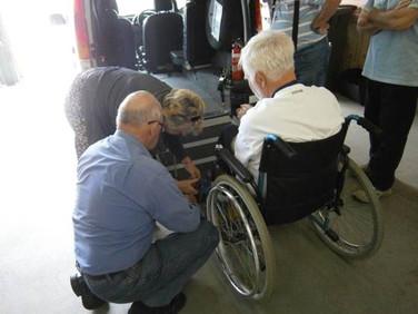 Volunteers undertaking wheelchair training