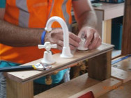 Home maintenance training, attaching taps