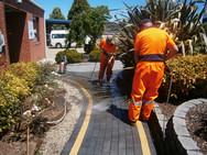 Volunteers Pressure Cleaning Footpath