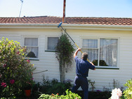 Man cleaning the gutters