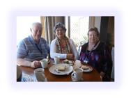Three people enjoying afternoon tea