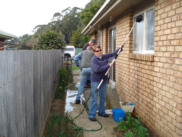 Volunteers helping to wash windows