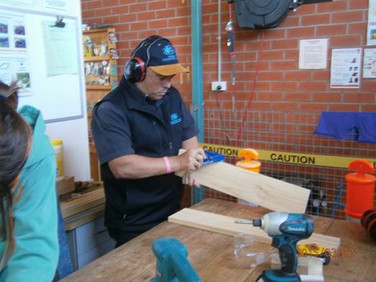 Volunteer doing woodwork