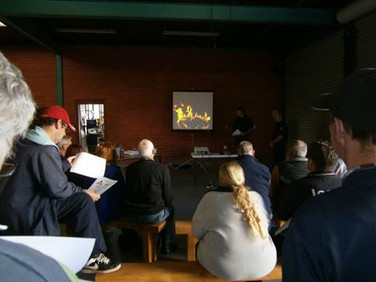 Volunteers watching a video during fire training