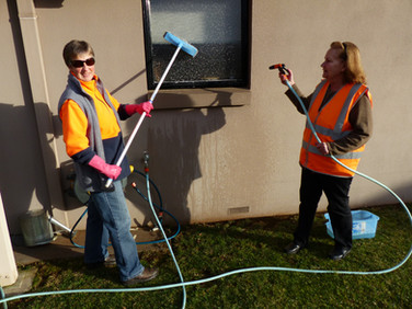 Volunteers enjoying washing windows