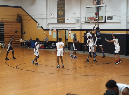 JV/Varsity Basketball: McCray, Brooks Lead Conquerors to Sweep of Englewood