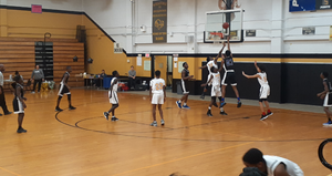 JV Conqueror Tomarion McCray sinks the layup as part of his 23-point night and 4-game, 83-point week.
