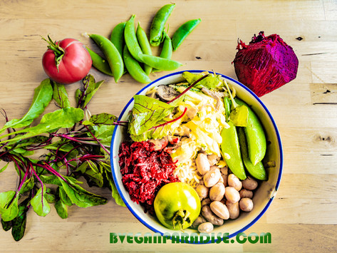 Buddha Bowl Filled with Rice, Grated Beetroot and Salad Mixed