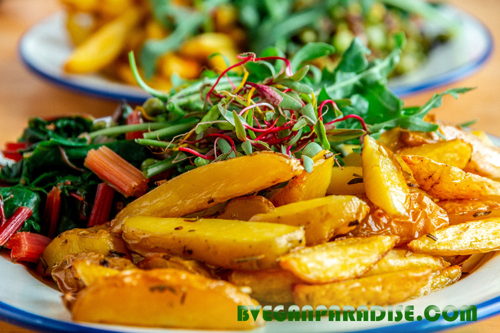Belgium Oven Fries with colourful beetroot seedlings on top from own allotment