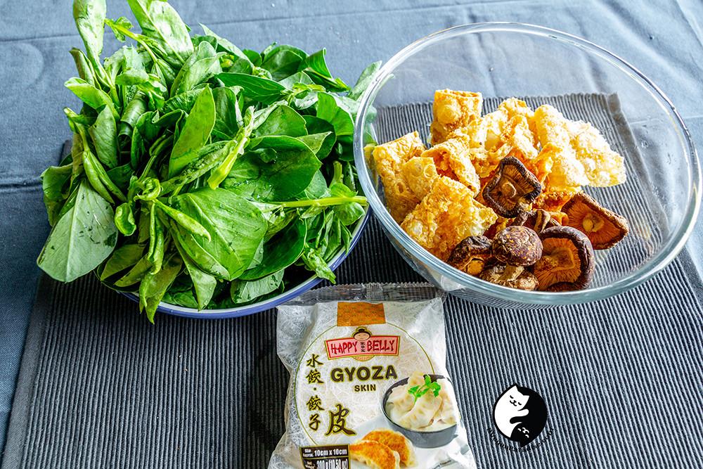 Ingredient of vegan dumplings: broad beans shoots, bean curd, shiitake and Gyoza skin.