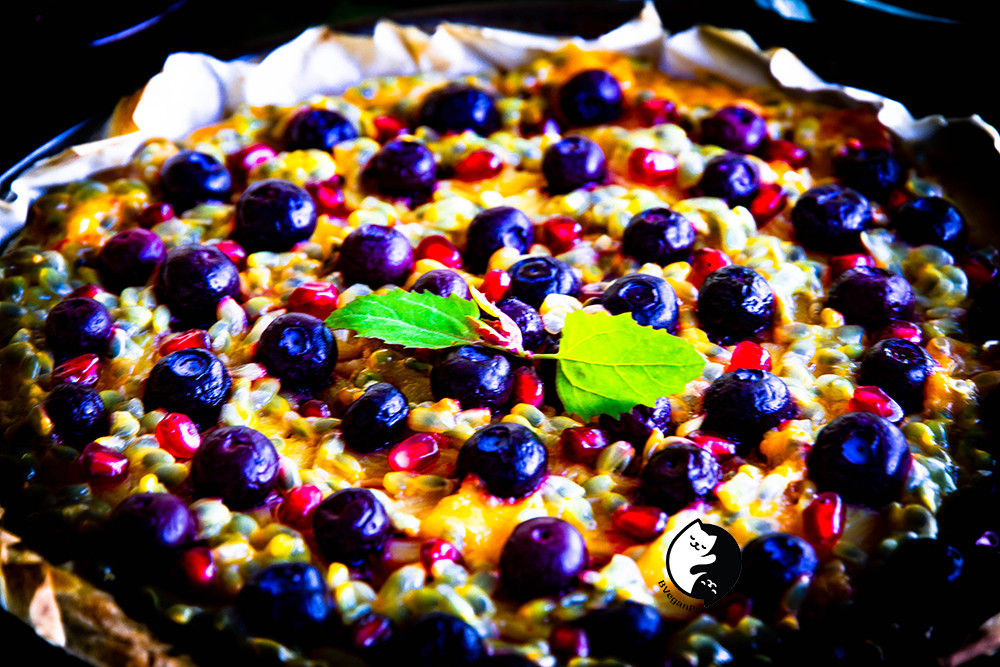 """A close up shot of pineapple pie. The decoration in the middle of this pie is called """"tree spinach"""" which has nice pink color in the middle. You can buy the seeds from your local (online) seeds provider."""