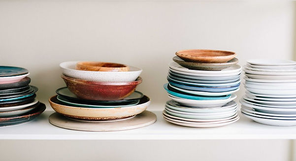 kitchen decluttering coloured plaes stacked