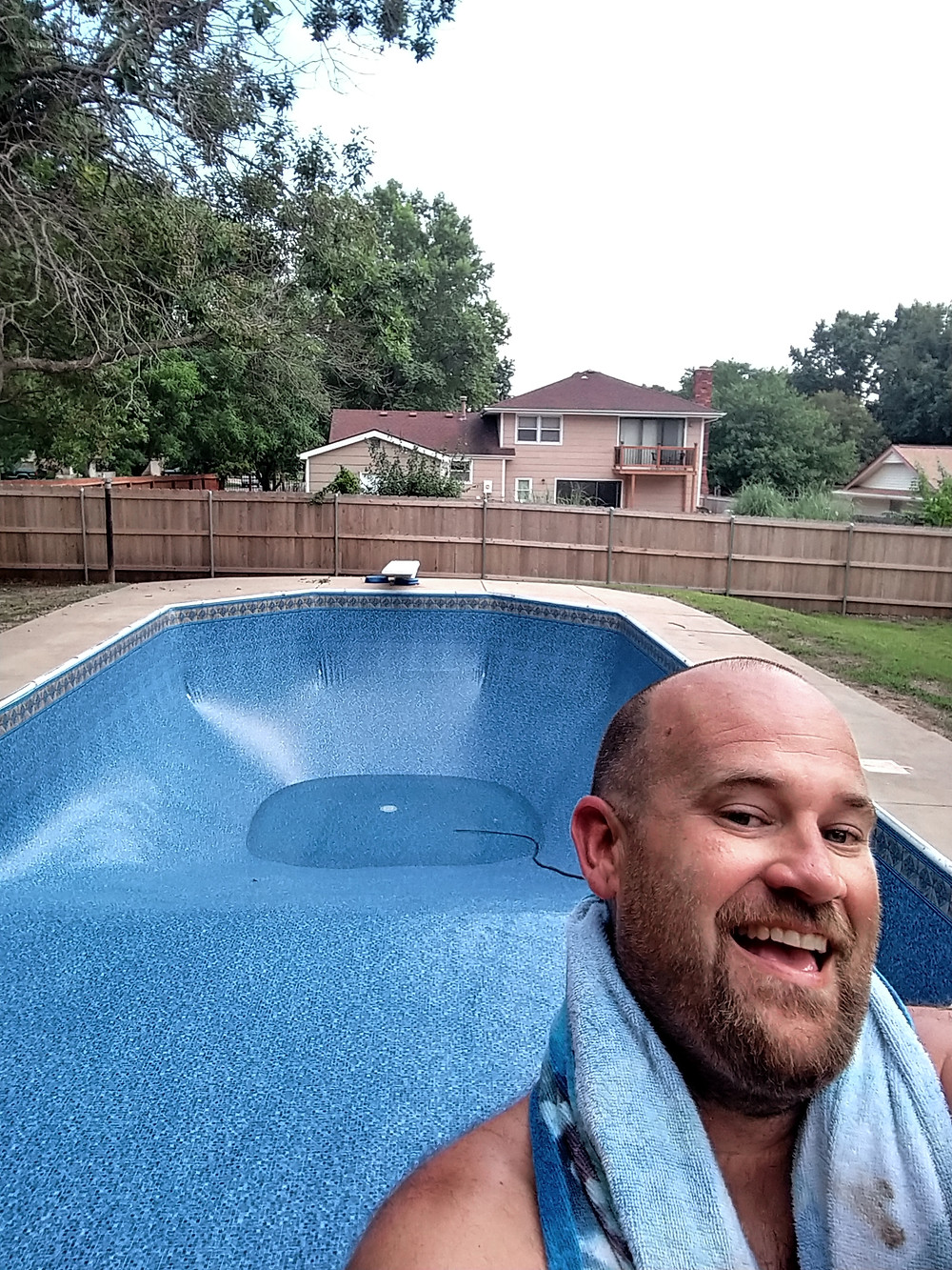 Man by Filling pool with new liner