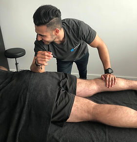 Our Remedial Massage Therapit Daniel treatng a patient for a hamstring injury at our Elevate Health Clinic in Bella Visa Norwest in the Hills District