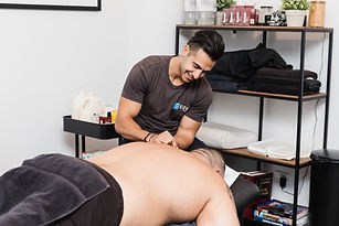 Remedial Massag Therapist Daniel treating a shoulder injury using Dry Needling at our Elevate Health Clinic Bella Vista Norwest in the Hill District