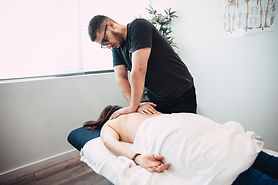 Chiropractor Kareem treating a patient with a sore neck. He is available at our Bella Vista, Norwest clinic and also treats patients from Castle Hill and Baulkham Hills