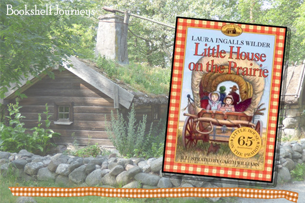 Little House on the Prairie book cover on rustic cabin photo by Terrie Purkey