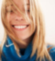happy blonde woman highlights and lowlights hair salon Great Falls, MT