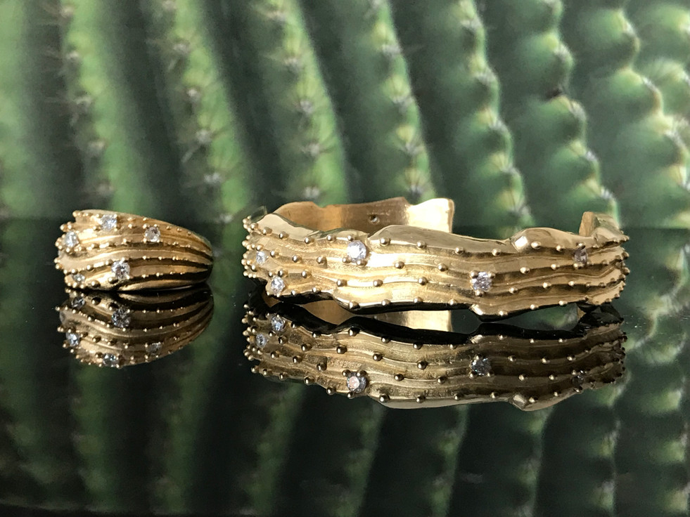 Cactus Cuff - 10K gold w/ natural white sapphires. Contact designer to inquire about princing in different metal.
