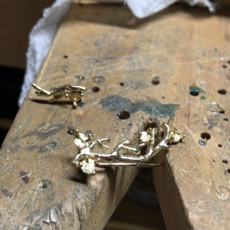 Assymetric 14k gold crawling earrings