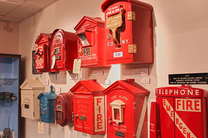 Fire alarm boxes, wall of.png