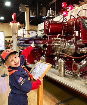 Tiger Scouts have fun at the Fire Museum.