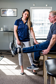 orthopedic physical therapist working with a patient