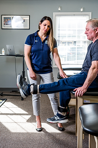 physical therapist treating a patient