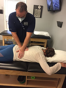 physical therapist using the McKenzie Method on a patient