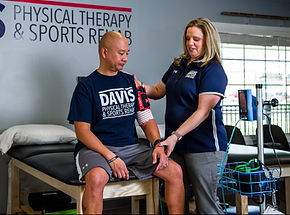 Dr. Davis treating a patient with Blood Flow Restriction