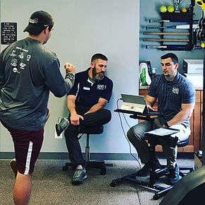 PT aides using DorsaVi with a patient during sports rehab