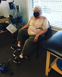 patient using the footbike during post-op rehab