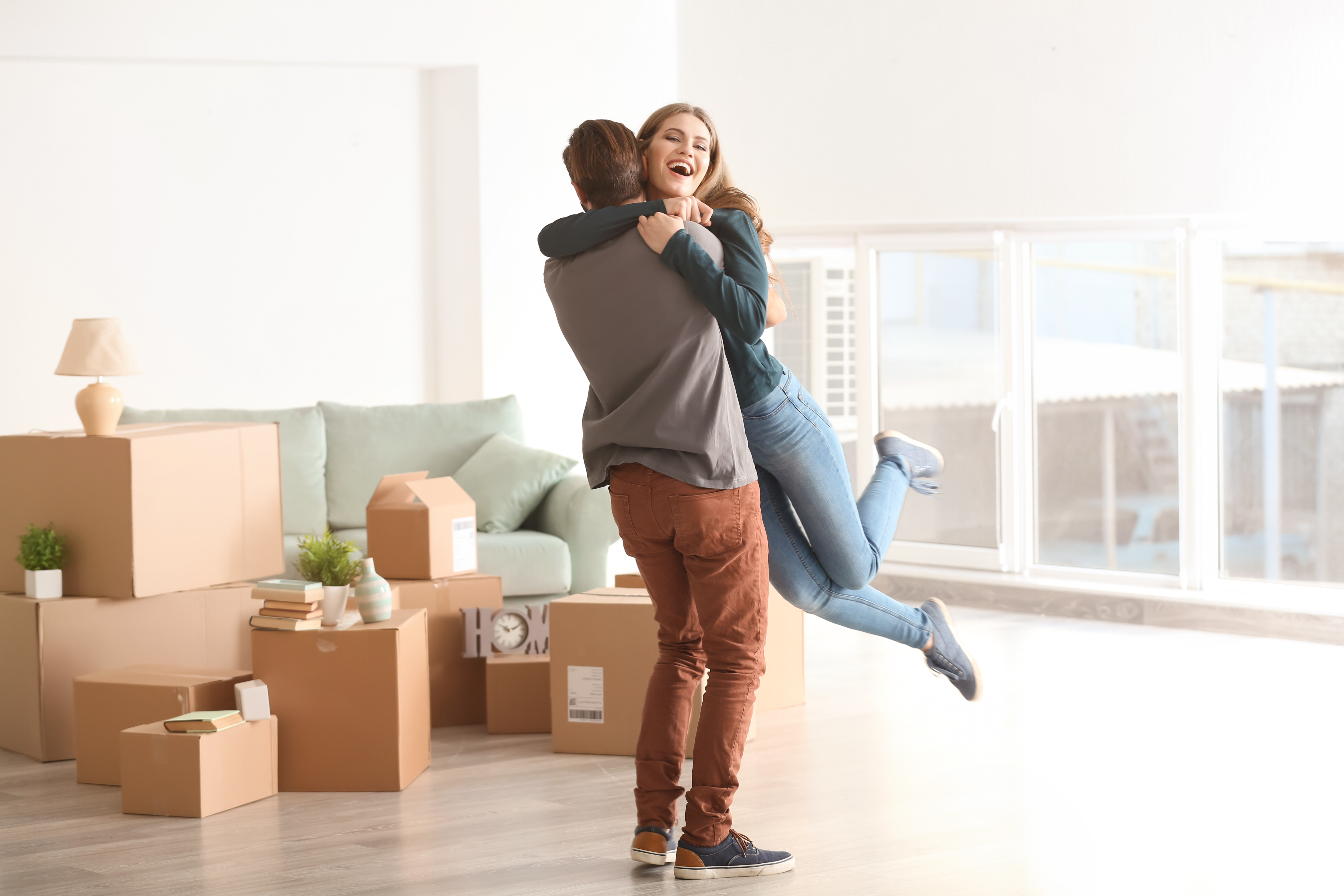 Young couple on moving homes boxes