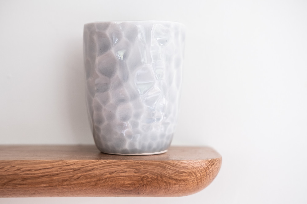 Glazed and fired slip cast porcelain cup